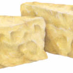 Two triangular wedge chunks of Parmesan cheese