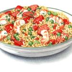 Bowl of Cajun paella with shrimp, sausage, rice, peas and tomatoes.