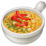 White ceramic crock of corn chowder with red pepper strips garnish.
